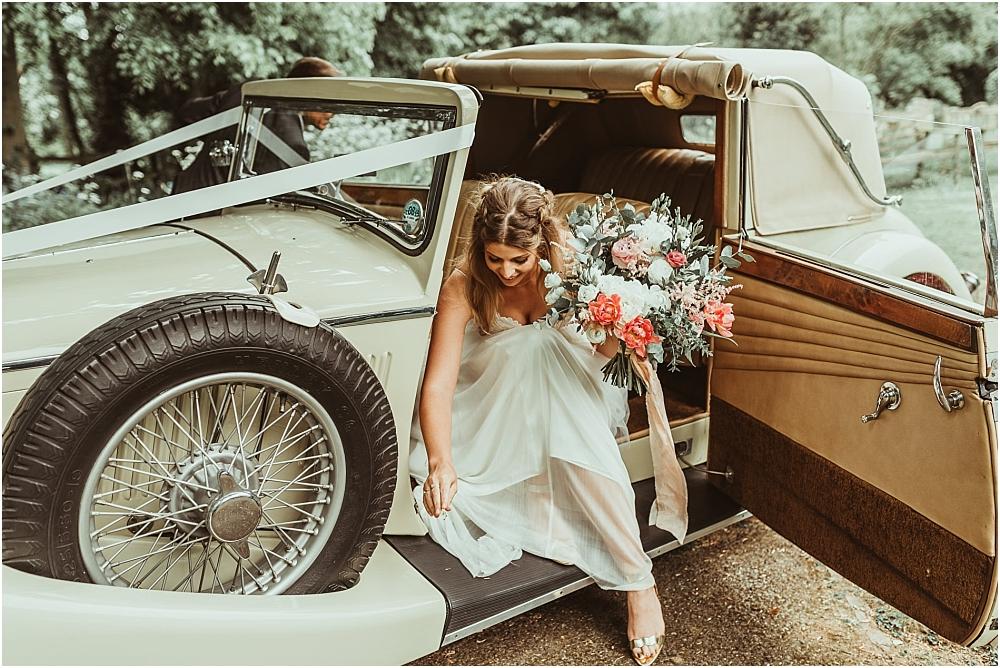 Boho Bride Vintage Car arrive at church