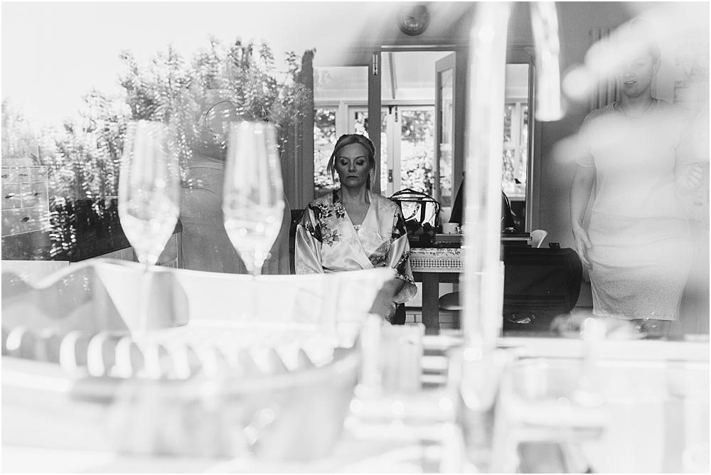 Bride getting ready for wedding at Saffron Walden