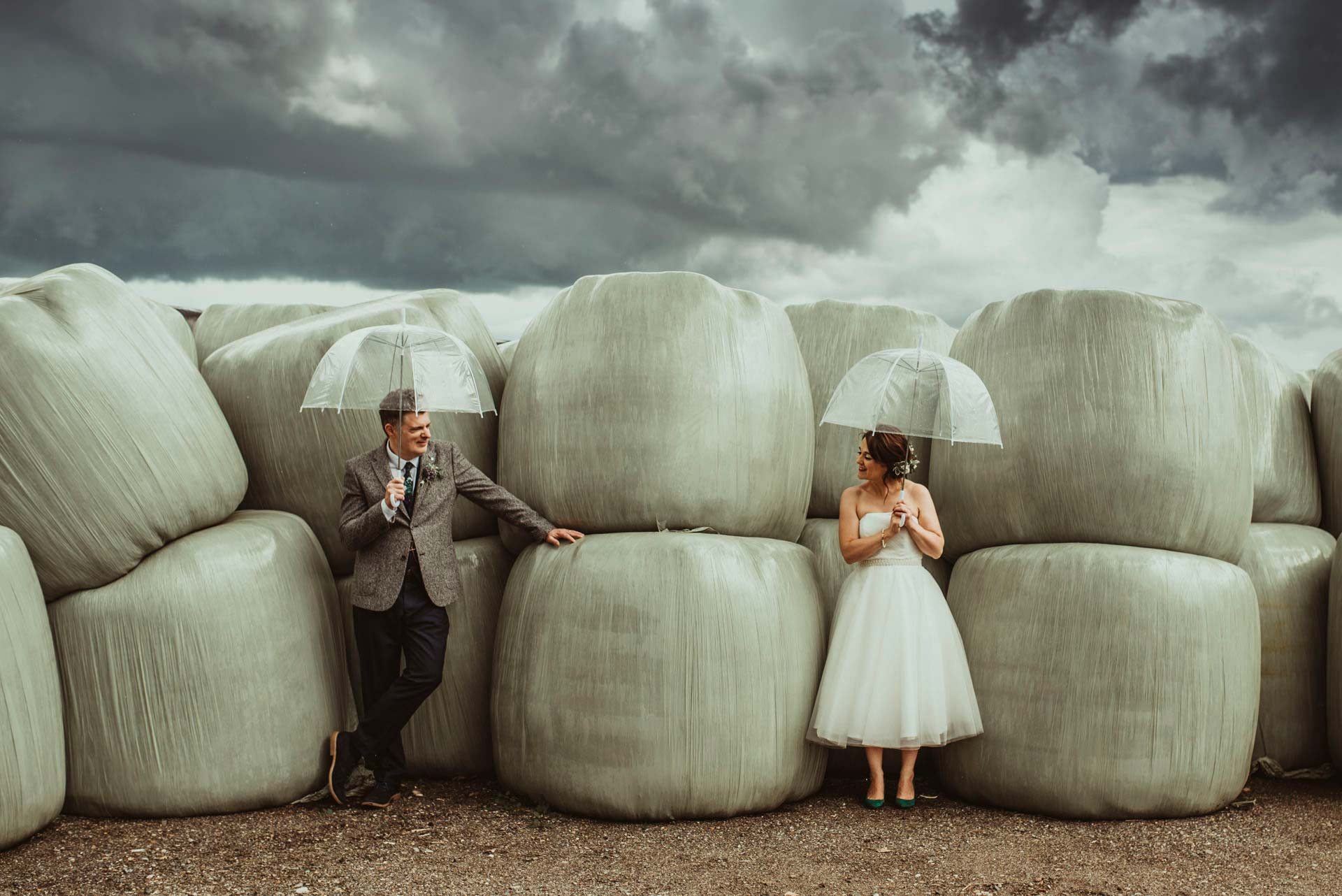 Alternative Essex Wedding Photographer Couple under umbrellas Jess Soper