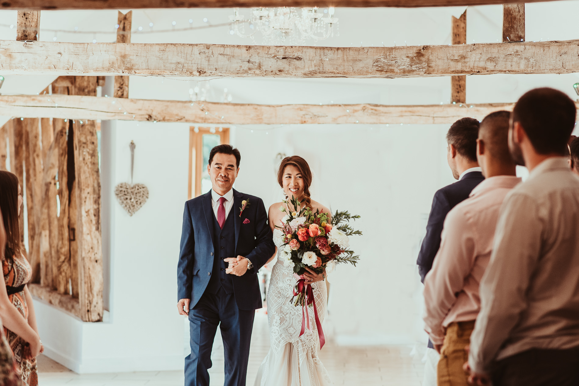 Father of the bride walking bride down the aisle at White Dove Barns
