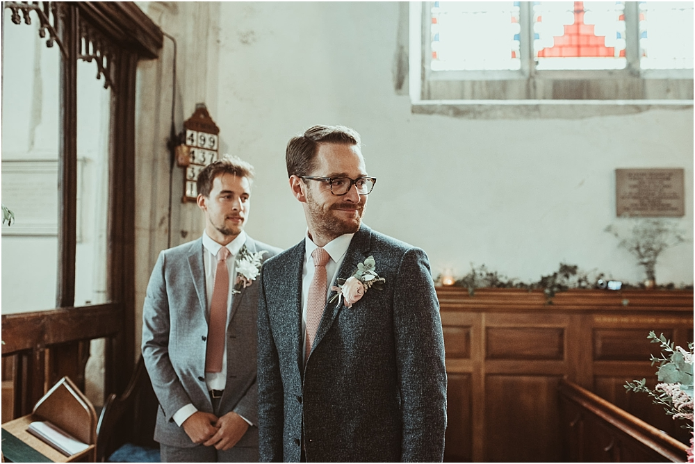Groom in Country church Essex Little Sampford
