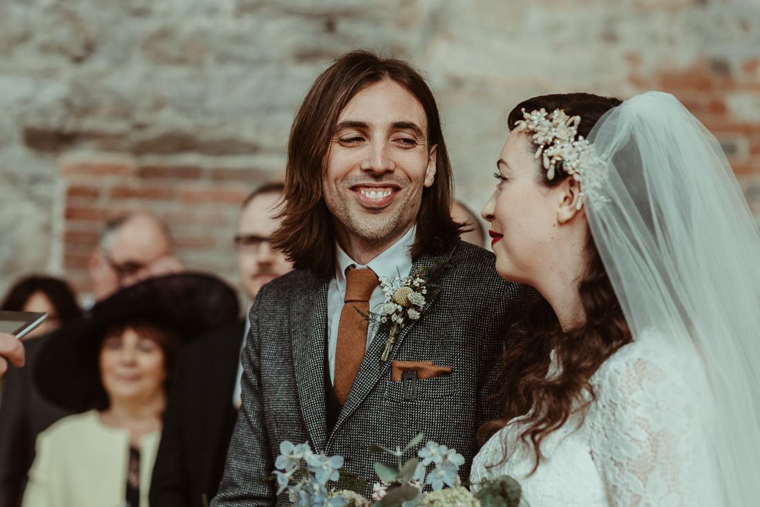 Lulworth Castle Wedding ceremony groom looking at bride