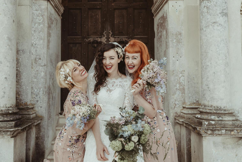 Alternative Essex Wedding Photographer-Jess Soper Bridesmaids laughing