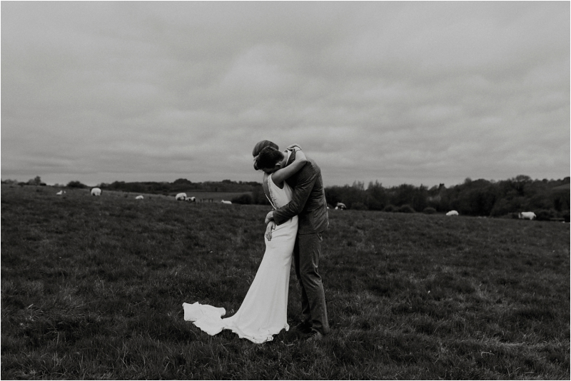 Couple embracing coronavirus wedding photography advice