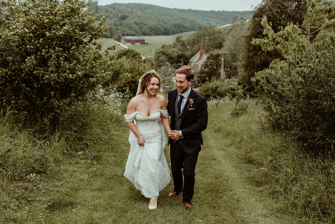 Bride and groom walking at Upwaltham Barns