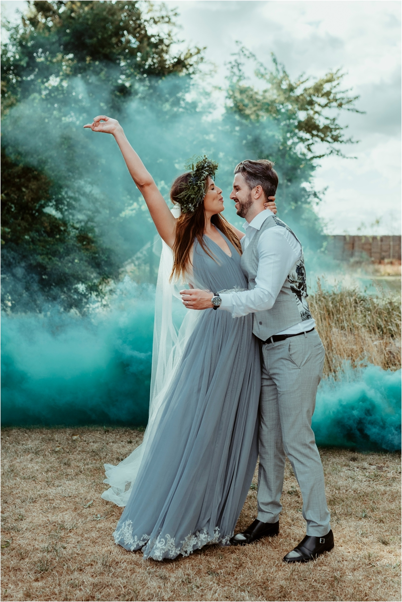 Couple with smoke bomb Tey Brook Orchard